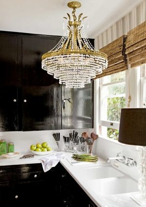 Chandlier in glamorous black and white kitchen.jpg