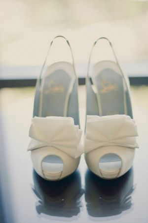 white Christian Louboutin shoes with bow.jpg