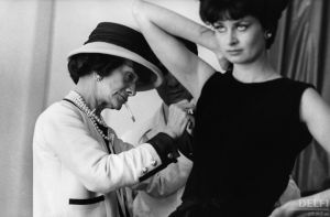 Coco Chanel adjusts a dress - Douglas Kirkland - July or August 1961 Paris.jpg