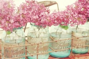 blue mason jars filled with spring blossoms.jpg
