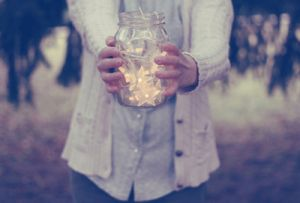 girl holding jar with lights in it.jpg