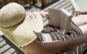 girl in hat reading a book in the sunshine.jpg