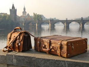 suitcases on the banks of the river - weheartit travel.jpg