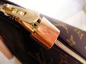 Living lusciously - louis Vuitton handbag clasp.jpg