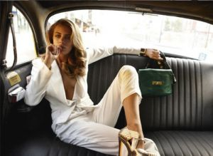 glam girl in white pants suit in limo.jpg