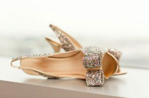glitter covered shoes with bow.jpg
