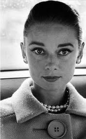 Audrey Hepburn in coat with pearls.jpg