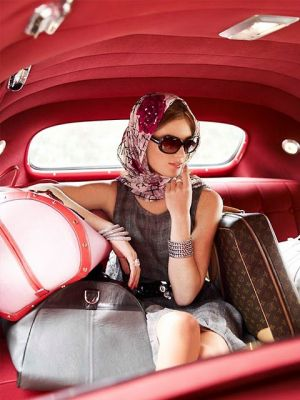 Glamorous model with LV luggage in car.jpeg