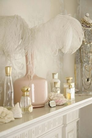 antique perfume bottles and feather.jpg
