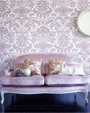 Purple patterned wallpaper and couch.jpg