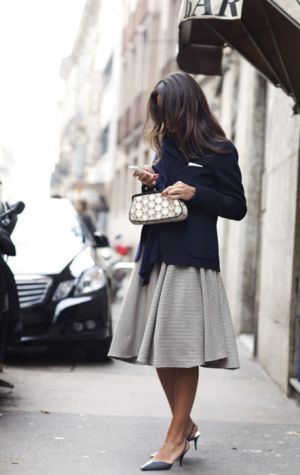 girl wearing blue and skirt on street.jpg