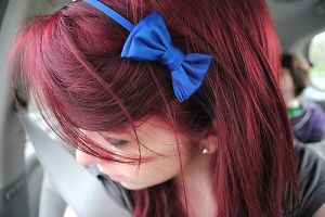 girl wearing blue bow in her hair.jpg