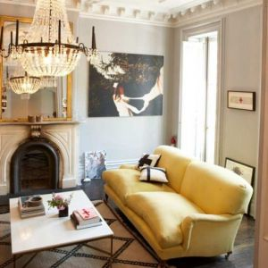 Decorating with yellow - palatial palate yellow living room chandelier.jpg