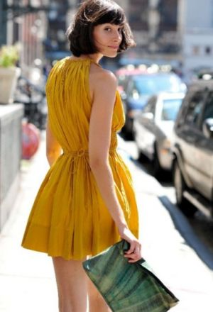 Girl in bright yellow frock.jpg