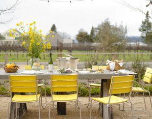 House Beautiful Jean Larette yellow outdoor table setting chairs.jpg