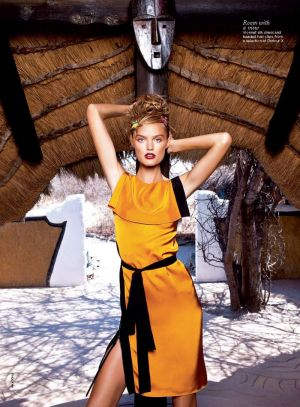Katie Fogarty by Max Doyle orange yellow black dress.jpg