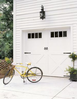 Light and bright yellow - carriage-house-style-garage-yellow-cruiser.jpg