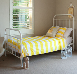 Yellow childrens bedroom white vintage bed striped yellow white linen.png