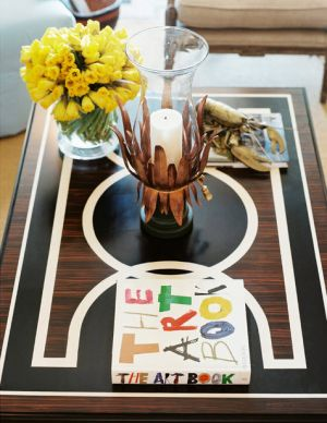 bunny williams coffee table setting with yellow flowers.jpg