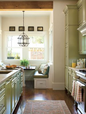 Luscious kitchen with banquette green tones.jpg