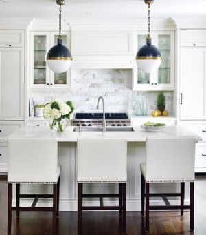 style at home kitchen white nailhead trim barstools cararra marble s.jpg