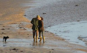 Kate and William walk on the beach with Lupo1.jpg