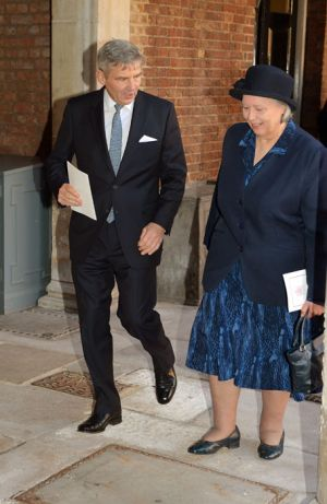 Michael Middleton leaves the ceremony with Prince George nanny Jessie Webb.jpg