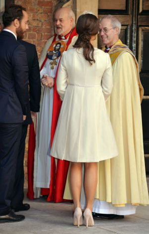 Pippa Middleton at Prince George christening in cream frockcoat.jpg