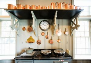 Martha Stewart copper pots in the stable kitchen Fall 2013.jpg