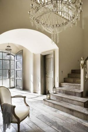 Chandelier in home entrance staircase via mylusciouslife.jpg