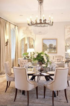 Elegant chandelier over dining table via HomeMint via mylusciouslife.jpg