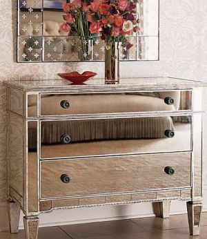Decorating with mirrored furniture - mirrored furniture chest of drawers.jpg