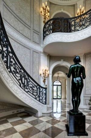 greige interiors - luscious entrance hall with staircase and sculpture.jpg