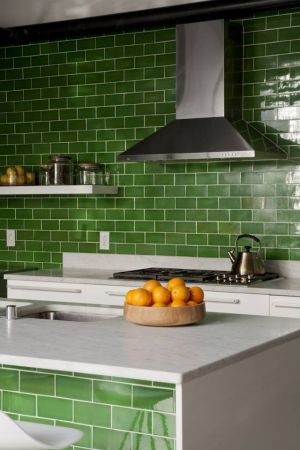 Beautiful houses and gardens - Green kitchen with subway tiles.jpg