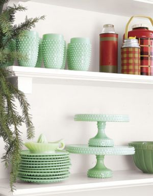 Ideas for decorating a beach house - Countryliving.com - Green and Red china on kitchen shelves.jpg