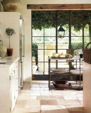 kitchen-window-frames-limestone-flooring.jpg