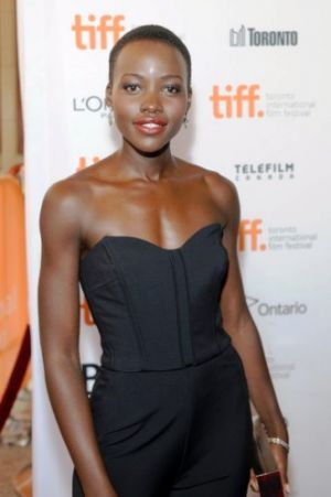 lupita-nyongo-tiff-hfpa-instyle-party-veronica-beard-scuba-bustier-jumpsuit-paul-andrew-printed-pumps.jpg