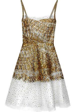 Oscar-de-la-renta-spring-2010-gold-dress-profile.jpg
