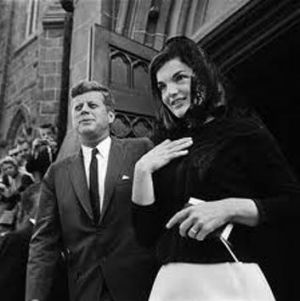 Hair trends - Jackie O wearing black lace headscarf.jpg