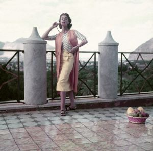 Model on Terrace in Yellow Sharkskin Skirt