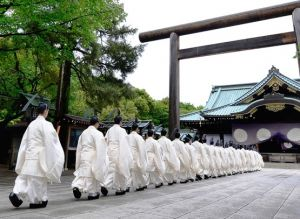 Monks in white at shrine - Japan.jpg