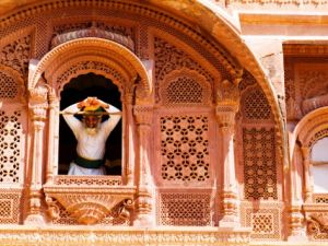 man-in-window-of-fort-palace-jodhpur-at-fort-mehrangarh-rajasthan-india.jpg