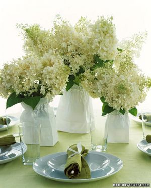 Martha Stewart - white flowers in paper bags on table.jpg