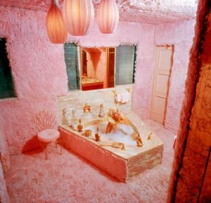 Jayne Mansfield in the pink carpeted bathroom in The Pink Palace Los Angeles 1960