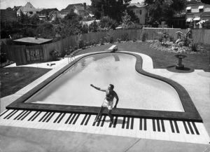 Liberace grand piano-shaped pool in his California backyard in 1954