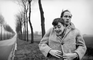 Mel Ferrer with his wife actress Audrey Hepburn  on a country road outside Paris 1956.jpg