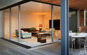 A geometric Hamptons house by Leroy Street Studio and decorator Thad Hayes Design-cabana-room.jpg