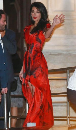Amal Alamuddin wearing a waterfall red and black printed dress from Alexander McQueen Resort 2011 collection.jpg
