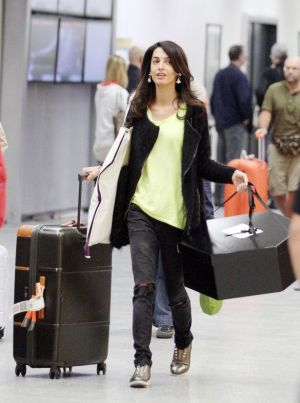 Amal-Alamuddin-arrives-at-the-airport-in-Italy pre-marriage-to-George-Clooney.jpg