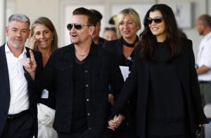 Irish singer Bono, lead singer of group U2, and his wife Hewson arrive to take a taxi boat transporting guests for the wedding of U.S. actor George Clooney and his fiancee Amal Alamuddin, in Venice